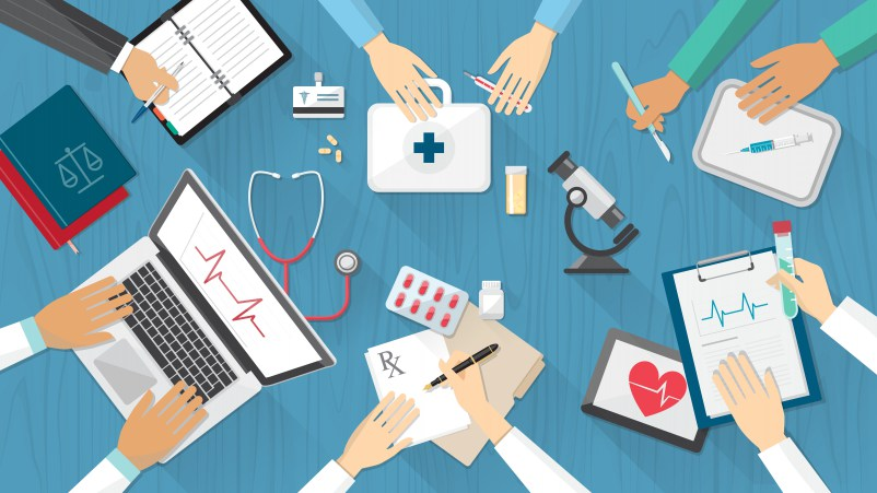 Medical team desktop with doctors and medical equipment